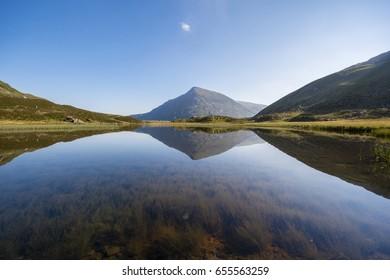 Pen Yr Ole Wen reflected in Cwm Idwal, Ogwen Valley