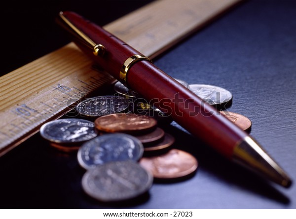 A pen,a ruler, and some change.