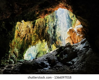 Penablanca, Cagayan Province, Philippines - May 19, 2008: View into one chamber of the limestone Callao Cave with sunlight entering from the rooftop