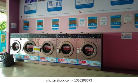 PENAGA, Malaysia - April 1st 2019 : Close-up of washing machine in local 24hours  self service laundry. Laundrybar is the concept of self-service laundry in Malaysia. (noise grain blurry visible)