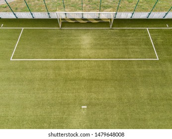 Penalty area of a football field with a view from the penalty spot direction football goal seen from the air