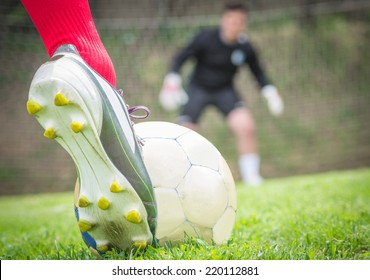 penalty kick. A soccer player is ready to hit the ball. Goalkeeper is gonna dive on the left