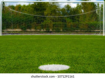 Penalty kick spot looking at an empty goal