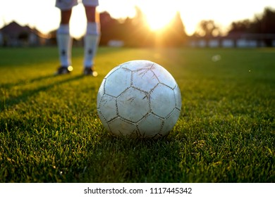 penalty kick training with a used ball in the sunset