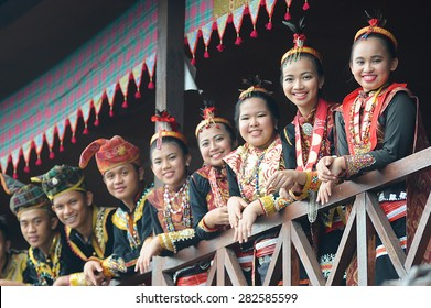 Penampang, Sabah Malaysia.May 30, 2015 : A group of people from Lotud tribe of Sabah Malaysian Borneo wearing traditional costume during Pesta Kaamatan.Image with selective focus on the ladies.