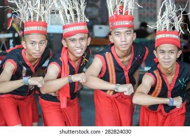 "Penampang, Sabah Malaysia.May 30, 2015 : A group of man from Dusun Keningau tribe gesturing ""Kotobian Tadau Kaamatan"" or happy harvest festival during Pesta Kaamatan in Penampang Malaysian Borneo."