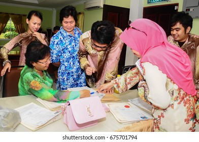 Penampang Sabah Malaysia - Mar 2, 2015:  Form six student receive his STPM examination result from his teacher.  STPM adopt new modular system which assesses students continuously over three terms.