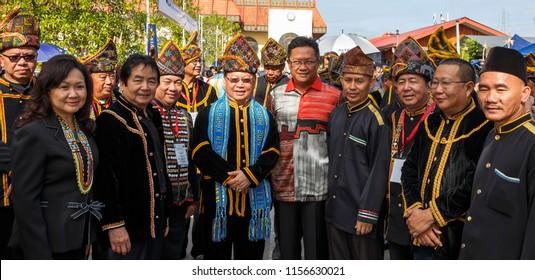 Penampang, Sabah, Malaysia - May 31 2014: Dignitaries at Kaamatan 2014, grouping around Datuk Pairin Kitingan at Kaamatan Festival at the Unity Hall of the Kadazandusun Cultural Association