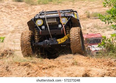 Penampang Sabah Malaysia - Oct 25, 2015 : Car enthusiast using modified four wheel drive vehicle in rough off road track in Sabah Borneo. Sabah Borneo is famous for 4x4 adventure tourism.
