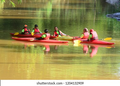 Penampang, Sabah, Malaysia - Sept 30, 2018 : A group of kayaking team gather around with their kayak in the river. Penampang folk urged to protect river and promote recreational activity.
