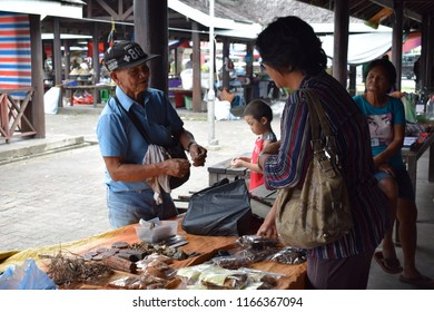 Penampang, Sabah-Aug 28, 2018: Bargaining for a better price always happens between buyer and seller at the Penampang tamu market which is in Sabah, Malaysia.