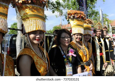 Penampang,Sabah-May 30,2016:Group of people of Kadazan tribe in traditional costume pose for camera during Kaamatan festival.Harvest festival,its a major yearly event for the Kadazandusun in Sabah,