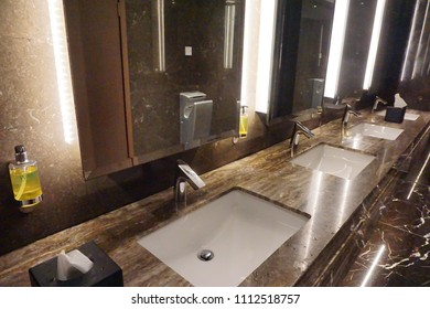 Penampang,Sabah-May 30,2018: Row of modern white ceramic wash basin in public toilet or restaurant or hotel or shopping mall, interior design