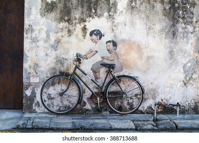 PENANG, DECEMBER 16, 2015:  Mural artwork by artist Ernest Zacharevic entitled Kids On Bicycle. The mural is located at Leboh Armenian.