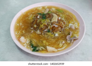 Penang famous hawker food Char Hor Fun. It is a stir fried flat rice noodles with treacly egg gravy.