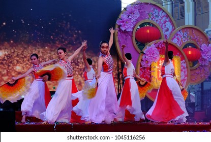 PENANG - FEB 21: Chinese dance troupe performs traditional dance with fan onstage at Penang street for closing day ceremony of Lunar New Year.Feb 21, 2018 in Penang, Malaysia.