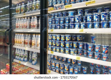 PENANG, MALAYSIA - 11 JUNE 2020: Rows of various brand of dairy products on refrigerated shelves in Giant grocery store Penang. Giant is a famous and trusted supermarket brand in Malaysia.