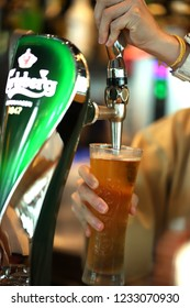 PENANG, MALAYSIA - 11 OCT 2018: View of Carlsberg brand of beer tab in the bar counter. Carlsberg is a global brewer, the company's headquarters is located in Copenhagen, Denmark.