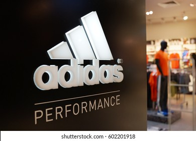 PENANG, MALAYSIA - 12 MARCH 2017: A sign for an Adidas retail store in Queensbay Mall Penang, Adidas is a German corporation that designs footwear and clothing.