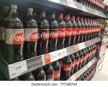 Penang, Malaysia - 14 December 2017 : Close-up picture of carbonated drinks bottle on shelf in supermarket
