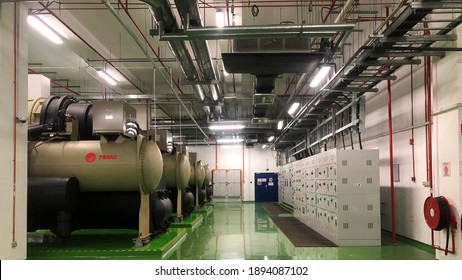 Penang, Malaysia - 15 January,2021: Electrical selector switch, electrical switch gear, motor control centre cabinet with chiller plant in building for manufacturing industry.