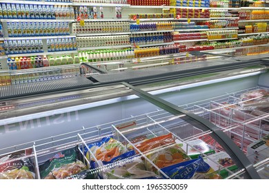 PENANG, MALAYSIA - 16 APR 2021: Interior view of huge glass fridge with various brand foods and beverage in Giant grocery store, Penang. Giant is a famous and trusted supermarket brand in Malaysia.