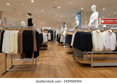 PENANG, MALAYSIA - 18 MAR 2021:  Interior view of Uniqlo store in a shopping mall, Penang. Uniqlo Co., Ltd. is a Japanese casual wear designer, manufacturer and retailer.