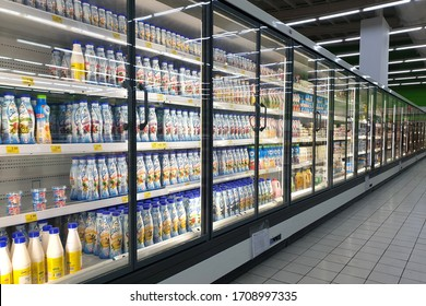 PENANG, MALAYSIA - 19 MAR 2020: Interior view of huge glass fridge with various brand foods and beverage in Giant grocery store, Penang. Giant is a famous and trusted supermarket brand in Malaysia.