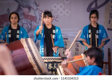 Penang Malaysia - 21st July , 2018: Action of the children play taiko drums during the Bon Ondari Festival at Esplanade Penang.
