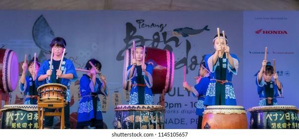 Penang Malaysia - 21st July , 2018: A group of children play taiko drums during the Bon Ondari Festival at Esplanade Penang.