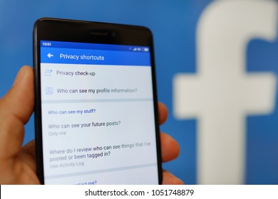 PENANG, MALAYSIA - 22 MARCH 2018: Facebook security and privacy issues. Close up hand holding a mobile phone with Facebook privacy check-up page infront of the logo