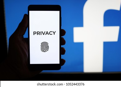 PENANG, MALAYSIA - 22 MARCH 2018: Facebook security and privacy issues. Close up hand holding a mobile phone with privacy check-up page infront of the Facebook logo.