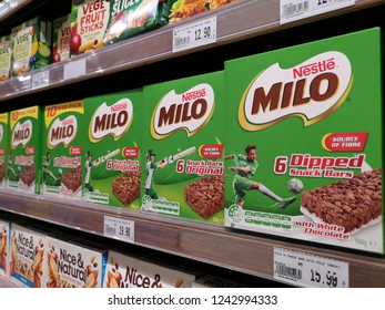 Penang, Malaysia - 23 November 2018 : Row a box of NESTLE Milo Dipped Snack Bars display for sell in the supermarket shelf.Milo is a produced manufacture by Nestle.