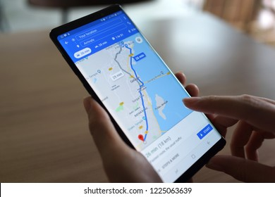 PENANG, MALAYSIA - 25 OCT 2018: Female using a Google Maps Application searching location on Android smartphone. Google Maps is a most popular web mapping service for mobile provided by Google inc.