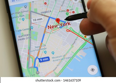 PENANG, MALAYSIA - 26 JULY 2019: Man using a Google Maps Navigation Application on Android smartphone. Google Maps is a most popular web mapping service for mobile provided by Google inc.