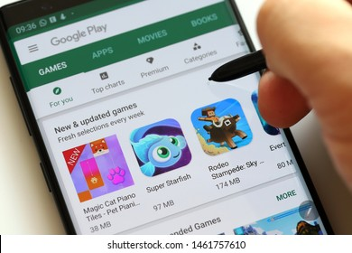 PENANG, MALAYSIA - 26 July 2019: User browsing Google Play Store on Android smartphone. Google Play is an app store for the Android OS, allowing users to download app, games, book, music and movies.
