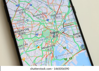 PENANG, MALAYSIA - 26 JULY 2019: Man using a Google Maps application plan for  holiday around Japan on Android phone. It is a most popular web mapping service for mobile provided by Google inc.