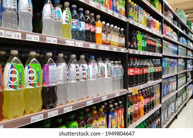 PENANG, MALAYSIA - 26 MAR 2021: Rows of shelves with various brands soft drink in Jaya grocery store, Penang.