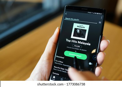 PENANG, MALAYSIA - 29 AUG 2018: Close up user browsing Smartphone and using Spotify application on the screen. Spotify is a music streaming platform developed by Swedish company Spotify Technology.