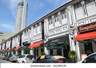 PENANG, MALAYSIA- 29 DECEMBER, 2016: View of Komtar Tower from one of the street in Penang. Tallest building of Penang island and the sixth tallest building in Malaysia