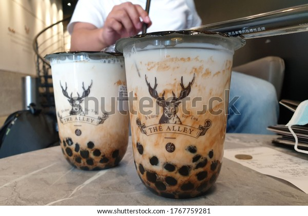 PENANG, MALAYSIA - 30 JUNE 2020: The Alley famous brown sugar milk tea with  tapioca pearls. Bubble tea is a Taiwanese tea-based drink invented in Tainan and Taichung in the 1980s.