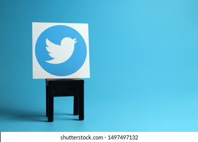 PENANG, MALAYSIA - 31 AUG 2019: Twitter logo on a black chair, light blue background. Twitter is a microblogging and social networking service.
