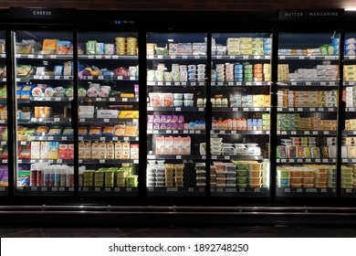 PENANG, MALAYSIA - 31 DEC 2020: Interior view of huge glass fridge with various brand foods and beverages in Mercato grocery store. Mercato is the coolest fresh premium supermarket in Malaysia.