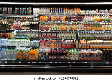 PENANG, MALAYSIA - 31 DEC 2020: View of various brand flavoured fruits beverages on the refrigerator shelf in Mercato grocery store. Mercato is the coolest fresh premium supermarket in Malaysia.