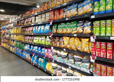 PENANG, MALAYSIA - 8 JULY 2020: Various local and imported brands of flavoured chips and snacks on store shelf in Mercato grocery store. Mercato is the coolest fresh premium supermarket in Malaysia.