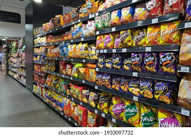 PENANG, MALAYSIA - 8 MAR 2021: Various local and imported brand of flavoured chips and snacks on store shelf in Mercato grocery store. Mercato is the coolest fresh premium supermarket in Malaysia.