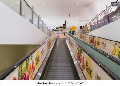 PENANG, MALAYSIA - APR 27, 2020: Flat escalator in Gurney Paragon with Jaya Grocer sticker beside the escalator
