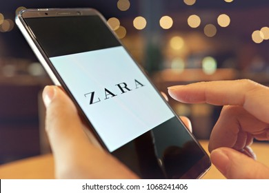 PENANG, MALAYSIA - April 13, 2018: Female holding Smartphone with Zara online shopping application on the screen. Zara is a Spanish fast fashion retailer based in Arteixo, Galicia.