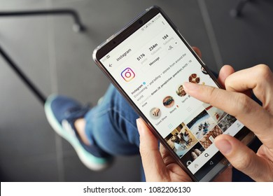 PENANG, MALAYSIA - April 13 2018: Woman holding smartphone with social internet service Instagram on the screen.