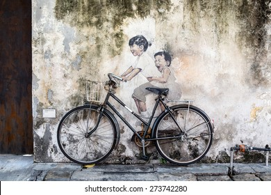 PENANG, MALAYSIA - APRIL 14: on April 15, 2015: street art name Kids on Bicycle in George Town Penang, Malaysia, April 14,2015